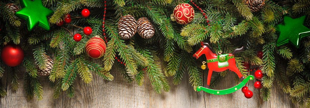 Pine branches decorated with Christmas ornaments