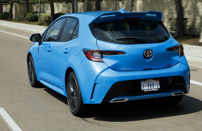 rear view of blue 2019 Toyota Corolla Hatchback driving
