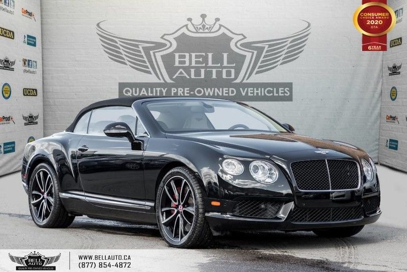 Exterior view of a black Bentley Continental in the Bell Auto Inc showroom