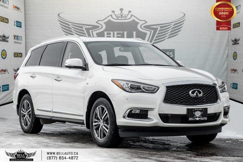 Exterior view of a white 2017 INFINITI QX60 in the Bell Auto Inc showroom