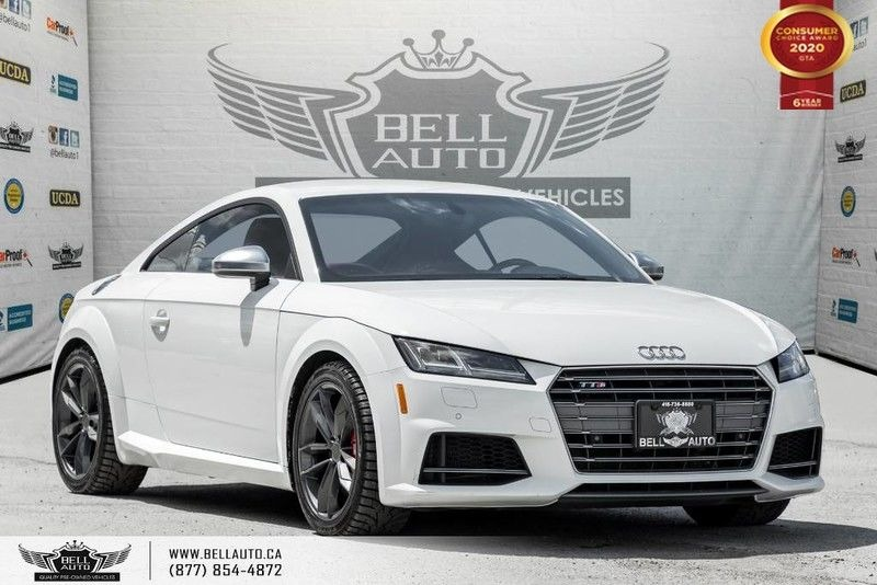 Exterior view of a white 2018 Audi TTS Coupe Quattro in the Bell Auto Inc showroom