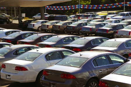 view of various of cars on car dealership lot