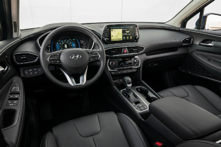 front interior of 2019 hyundai santa fe including steering wheel and infotainment system