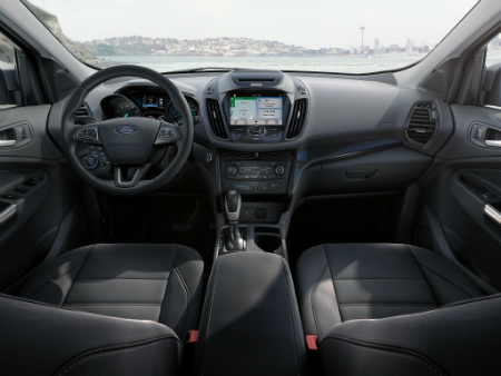front interior of 2018 ford escape including steering wheel and infotainment system