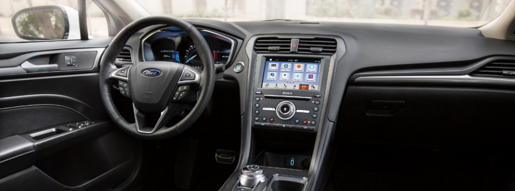 front interior of 2019 ford fusion including steering wheel and infotainment system