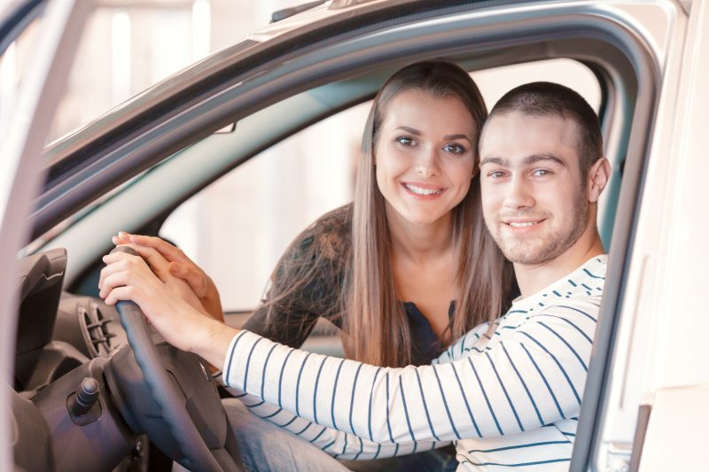 young couple inside a vehicle