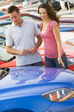 Young couple shopping for a car