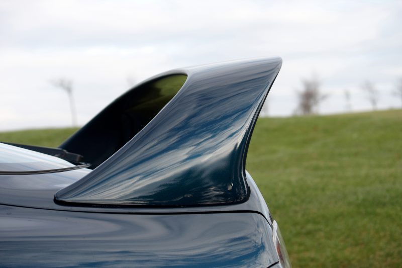 A spoiler on the rear end of a car