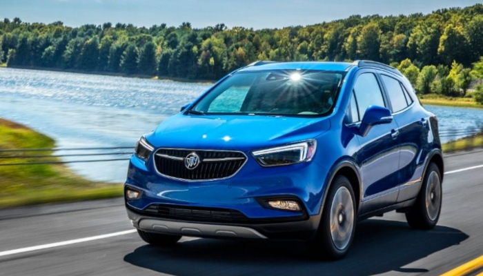 2019 Buick Encore driving near a lake.