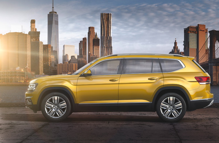 Yellow 2018 VW Atlas with a City Skyline in the Background