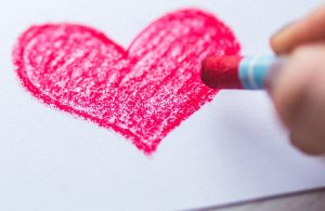 child-drawing-a-red-heart