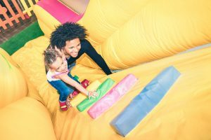 dad-and-daughter-climbing-inflatable-playground