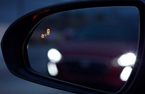 2018 Hyundai Elantra GT side mirror showing how the blind spot warning system in action