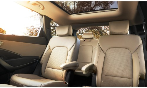 2019 Hyundai Santa Fe XL interior shot of back row seating and upholstery and sun coming through the windows and sunroof
