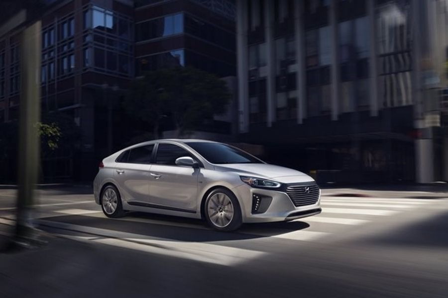 Silver 2019 Hyundai Iqonic from front passenger side in city