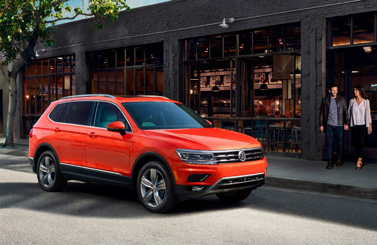 Red-2018-Volkswagen-Tiguan-parked-in-front-of-building