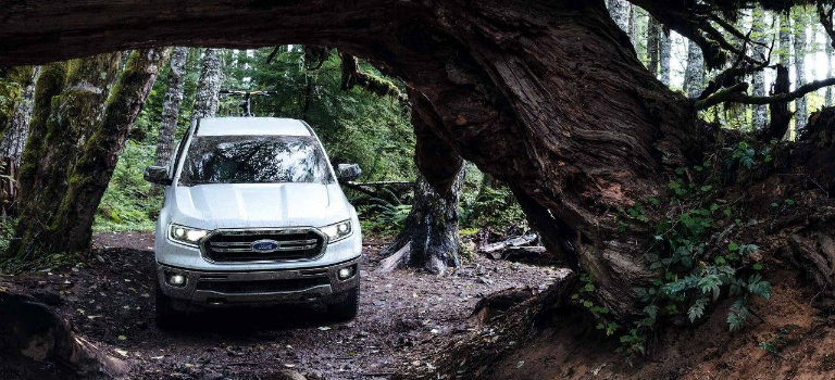 front-view-of-white-2019-Ford-Ranger-driving-through-woods