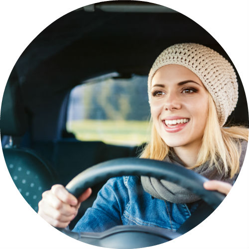blonde-girl-in-beanie-driving-car-alone