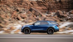 2019 Ford Explorer driving past a mountain