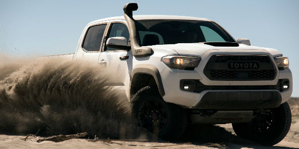 Super White 2019 Toyota Tacoma TRD Pro Kicking Up Sand in Desert