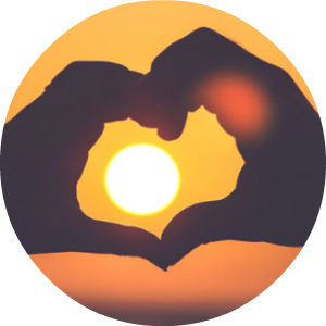 Two Hands Making a Heart with Sunset in the Middle