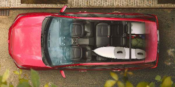Overhead and Cutaway View of 2019 Toyota RAV4 Cargo Space with Surfboard in Back