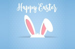Cartoon White Rabbit Ears on Blue Background with White Happy Easter Text