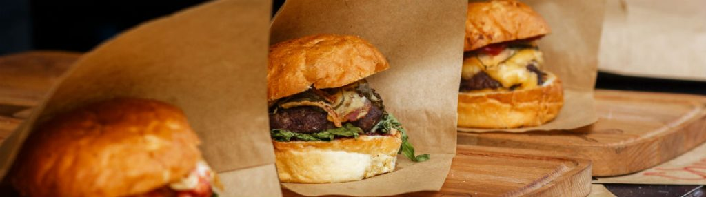 burgers wrapped in fancy craft paper