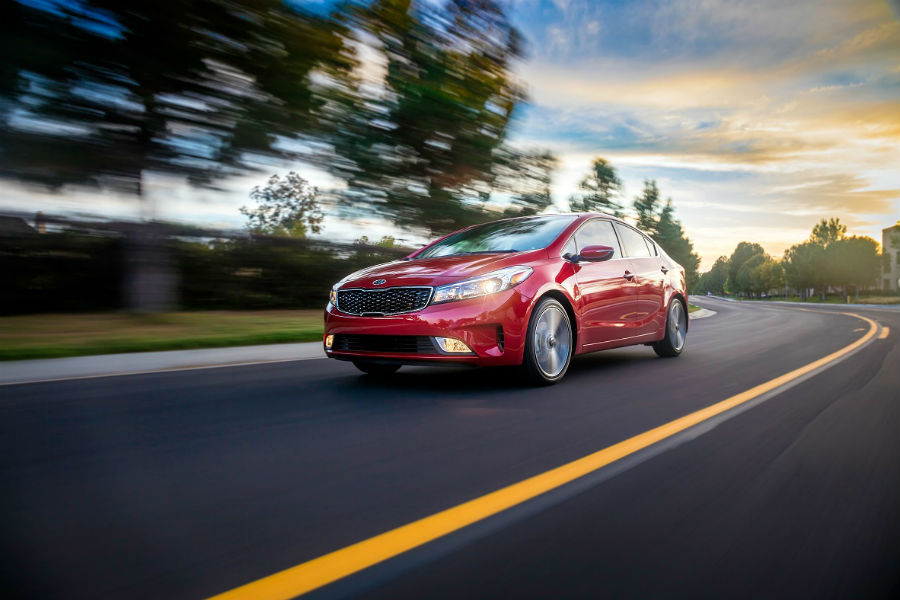 2018 kia forte driving in red
