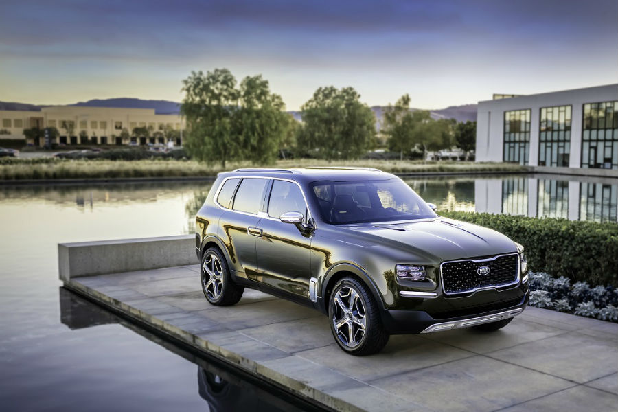 kia telluride exterior isometric view in front of mansion home