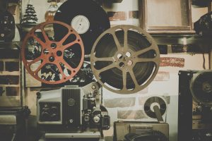 old film projector and reels next to it