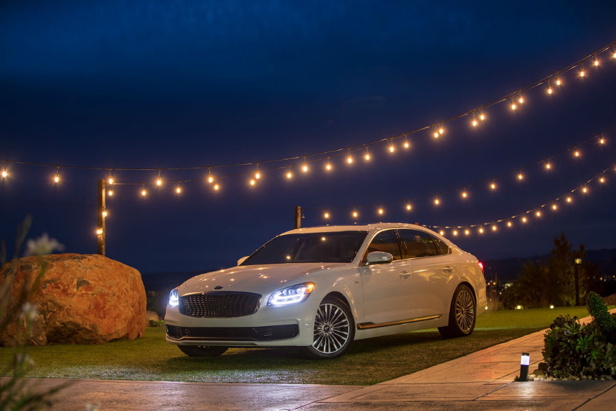 2019 kia k900 out at night under cafe lights on a dock