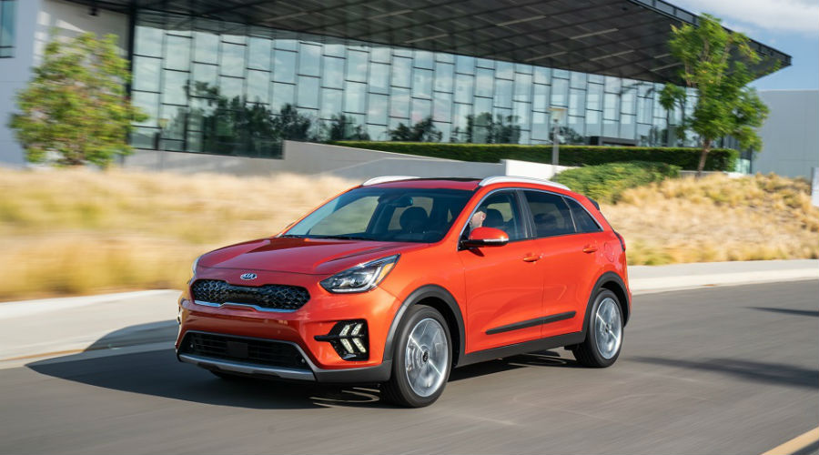 red 2020 kia niro driving in city near port richey, florida