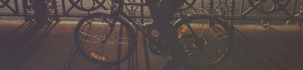 person riding bicycle at dusk