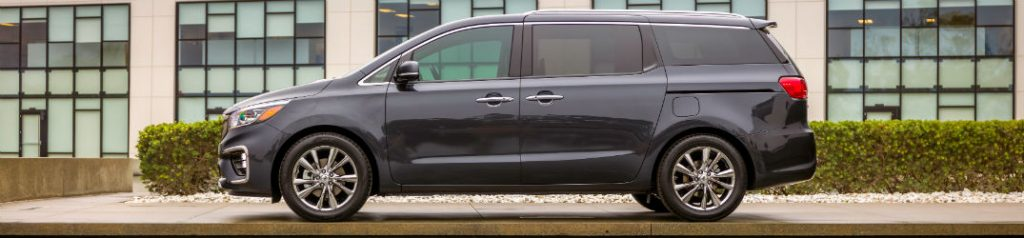 Side view of black 2020 Kia Sedona