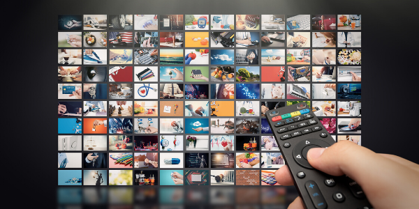 Remote control pointing at arrangement of icons on tv screen