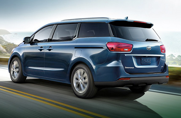 Rear view of blue 2020 Kia Sedona
