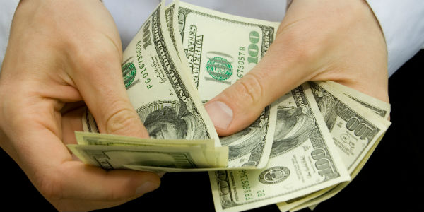 Closeup of hands counting money
