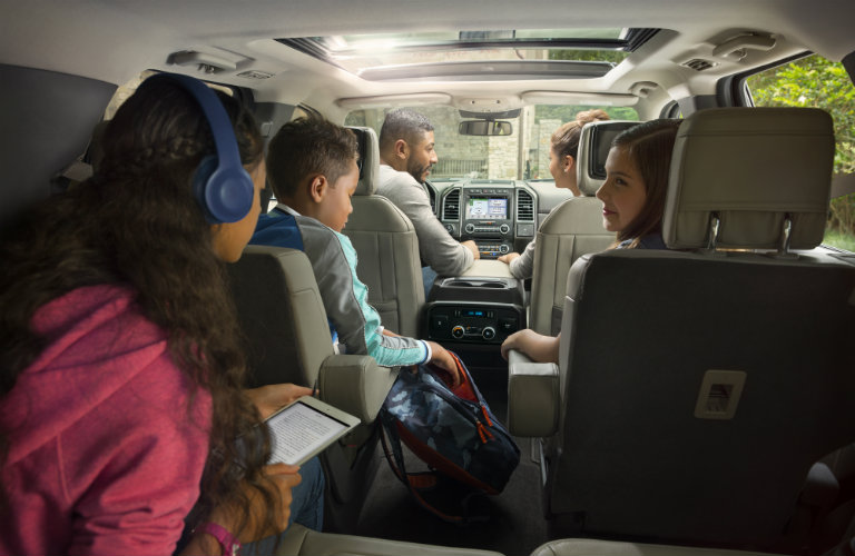 a family inside the 2018 Ford Expedition