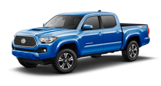 A front left quarter view of a Blazing Blue Pearl 2018 Tacoma