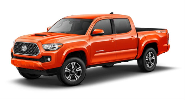 An Inferno colored 2018 Tacoma showing its right front corner