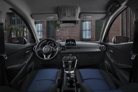 front interior of 2018 toyota yaris ia including steering wheel and dashboard