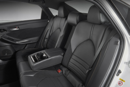 rear seating of 2019 toyota avalon including arm rest and cupholders