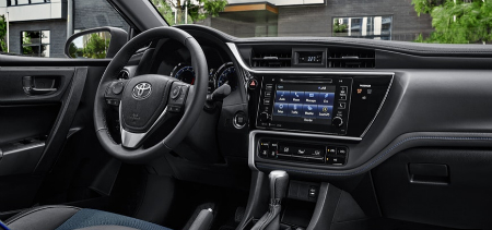 front interior of 2019 toyota corolla sedan including steering wheel and infotainment system