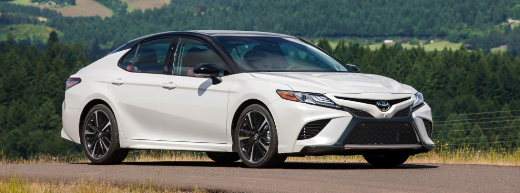 front and side view of white 2019 toyota camry
