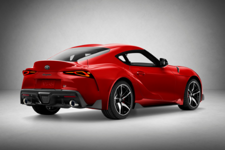 rear and side view of red 2020 toyota supra