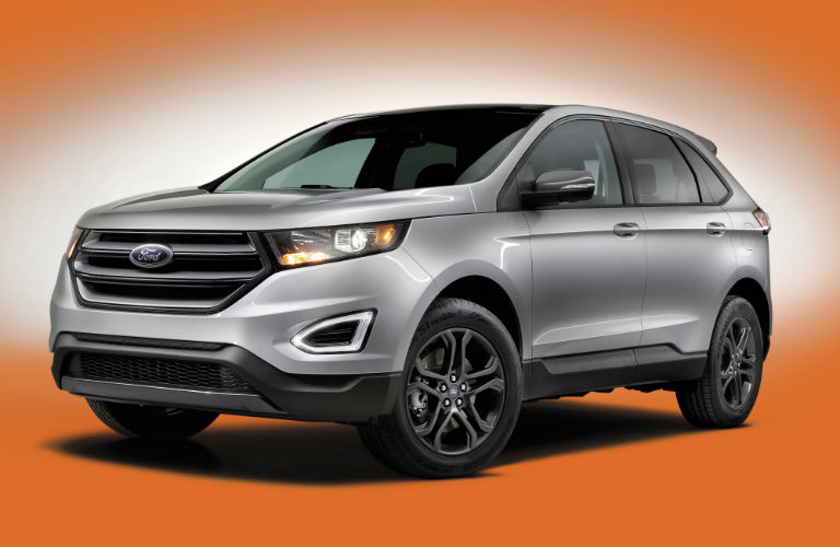 grey 2018 Ford Edge on an orange background