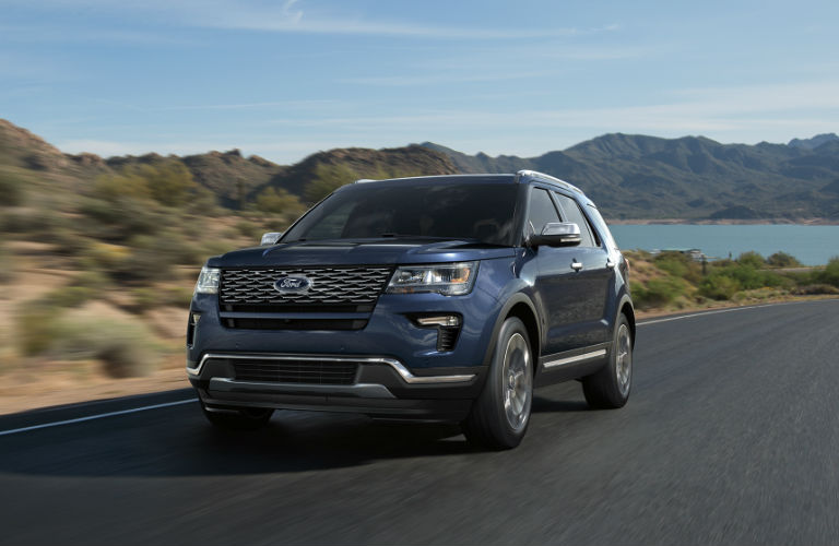 blue 2018 Ford Explorer driving in the country