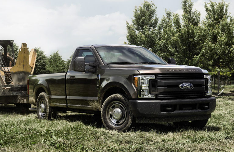 2018 Ford F-350 Super Duty in black parked on grass