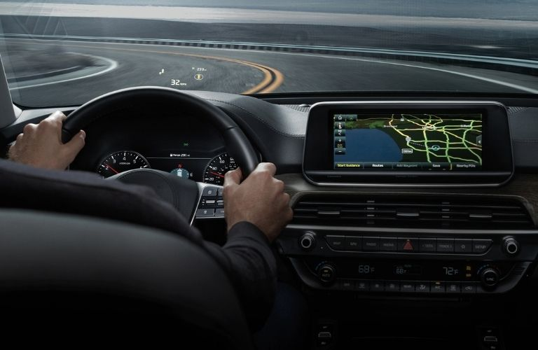 Interior view of the 2021 Kia Telluride with a driver using the navigation system